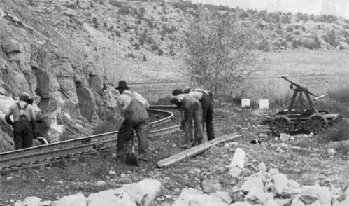 workers build railroad