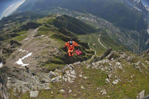 two people fly with wingsuits